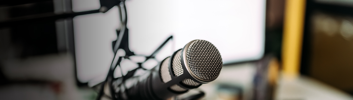 microphone close-up depicting Press coverage